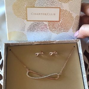 Brand new boxed necklace and earrings set.Rosegold